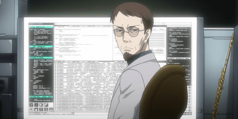 Aeolia Schenberg with glasses in front of huge computer screen