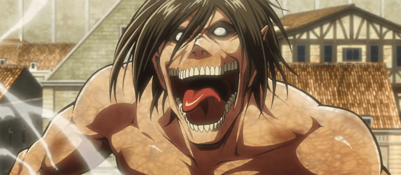 Eren Yeager in his titan form looking crazed in the city