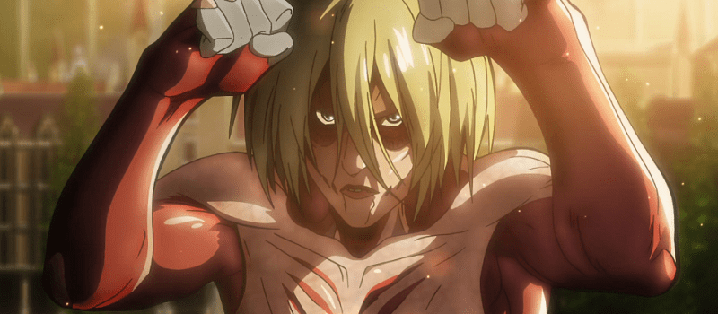 Female Titan ready to fight with both hands up in the city
