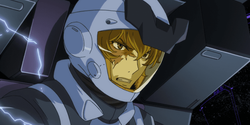 Graham Aker angrily looking around in his mobile suit