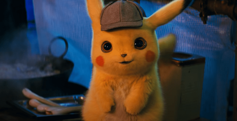 Pikachu sitting near a grill and wearing a detective hat