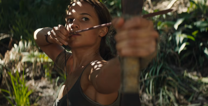 Lara Croft shooting a bow and arrow in the jungle