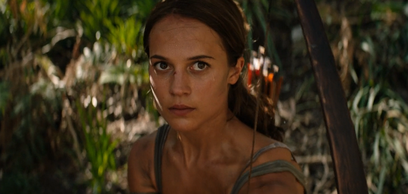 Lara Croft holding a bow in the jungle