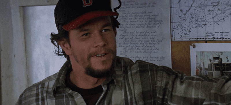 Mark Wahlberg smiling in a Boston hat on Andrea Gail
