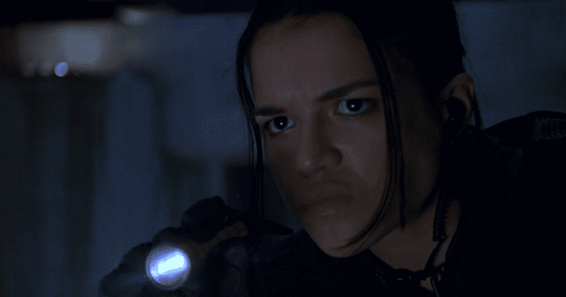 Michelle Rodriguez with a flashlight in Resident Evil