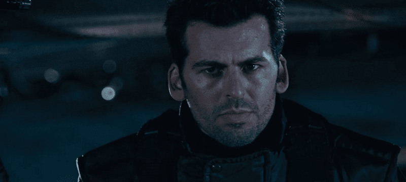 Oded Fehr looking serious in the darkness